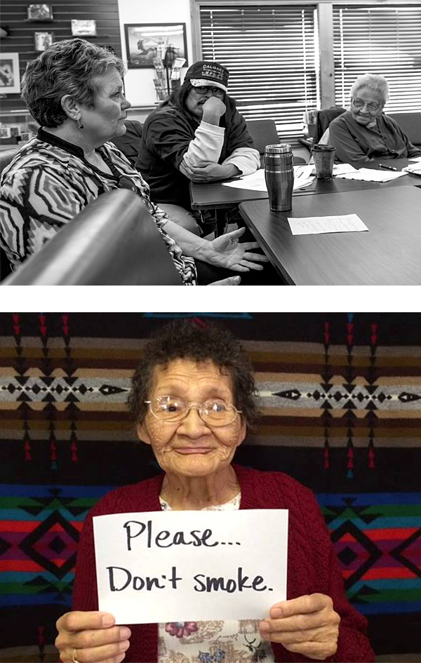 "Lakota members at meeting. A Lakota elder holding a handwritten card that says, ""Please...don't smoke."""